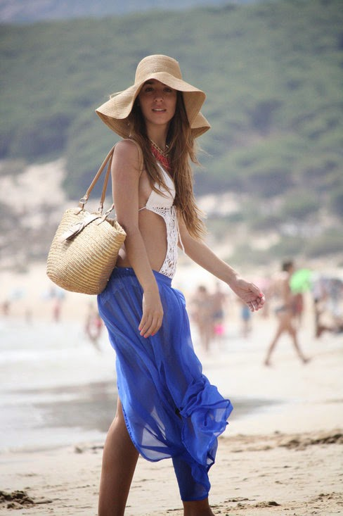 Wearing a White Crochet Monokini and Blue Skirt for a Stylish Beach Look