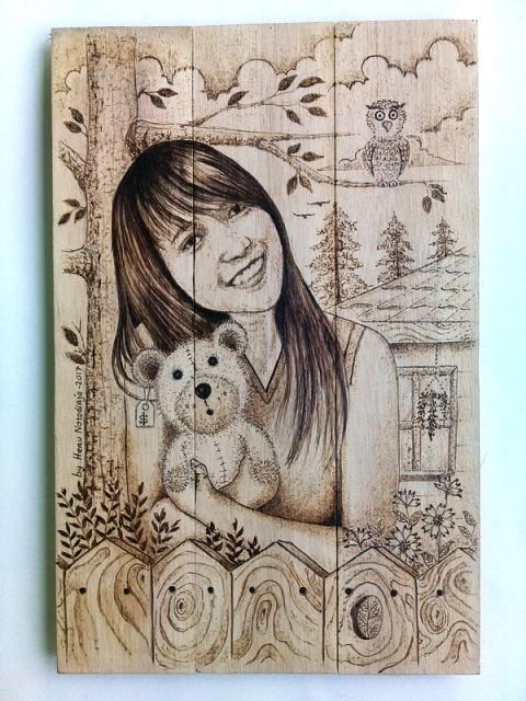 Lukisan wajah pirografi Andrea