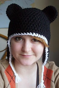 http://www.ravelry.com/patterns/library/adult-laplander-hat-with-teddy-bear-ears