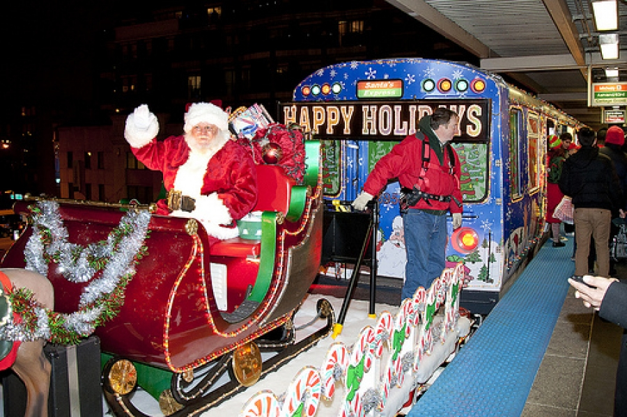 santa and his elves will ride the train passing out candy canes and seasons greetings - Christmas Train Chicago