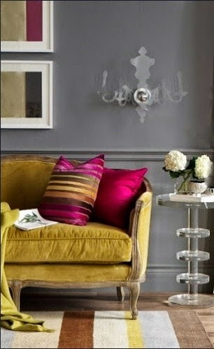 pink and gold cushions with grey wall