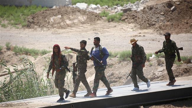 US-backed militants take last road into Syria's Raqqah