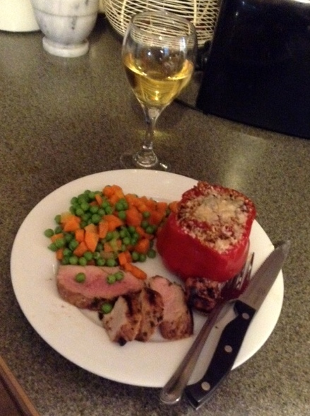 plate with stuffed peppers, pork tenderloin and carrots and peas