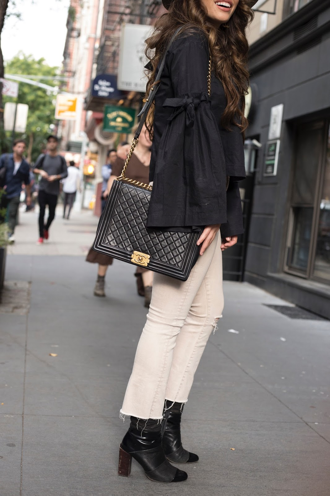 fall fashion, black and cream, black long sleeve top, nyc fall fashion, nyc fashion, how to dress for nyc in the fall, nyc blogger style, blogger style, top bloggers nyc, free people top, free people long sleeve black top, mother jeans, chanel boy bag xl, xl black and gold chanel boy bag, chanel double c earrings, chanel earrings, gold chanel earrings, elle harper blog, elle harper, elle harper nyc, long brown hair, khaki denim, janessa leone hat, brown janessa leone, how to dress for fall, black booties, new bloggers