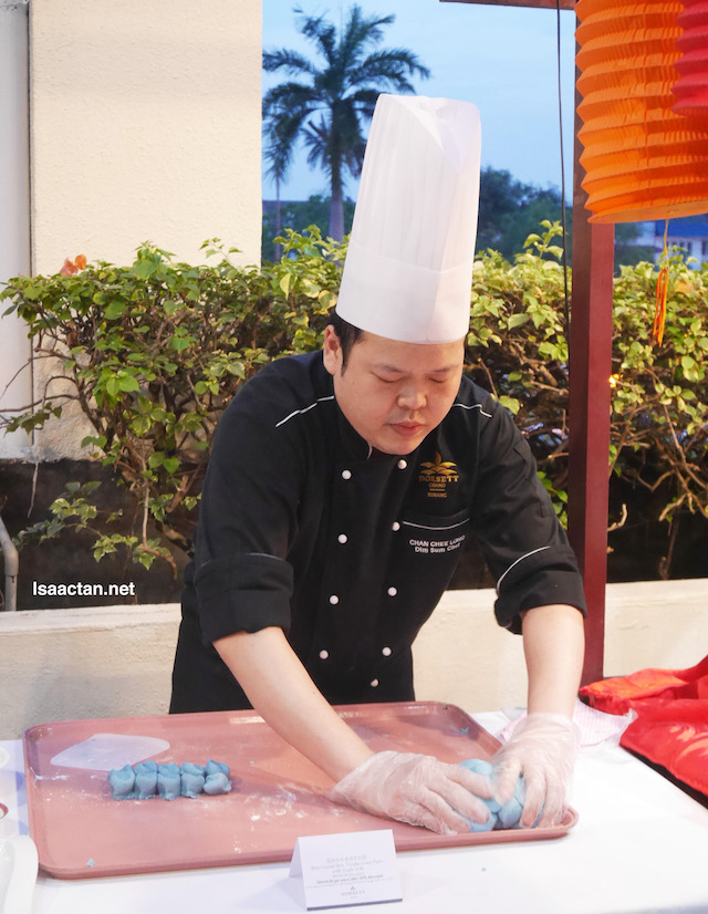 Master Chef Alex Chan making the signature Crystal Skin Pandan Lotus Paste with Single Yolk