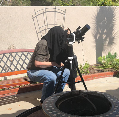 Resident Astronomer goes under the hood with camera and takes images of the sun (Source: Palmia Observatory)