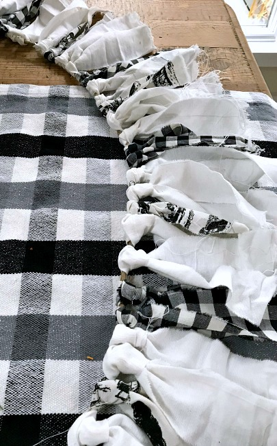 Black and white garland on buffalo check fabric