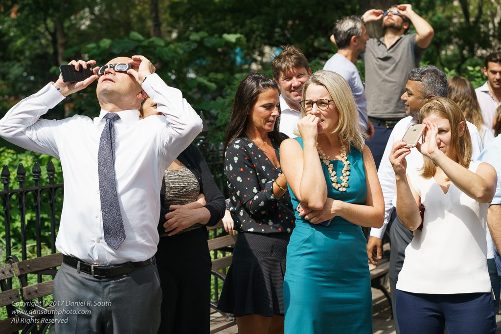 a photo of office workers in new york viewing the eclipse summer 2017