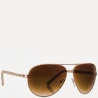 c088e07815213 Óculos médio estilo aviador com armação de metal prateado esmaltada em  marfim e haste com revestimento em couro sintético marfim.