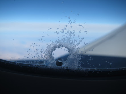 Hole in aircraft window- Breather Hole