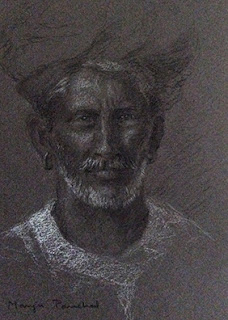 Charcoal portrait of a man from Rajasthan, by Manju Panchal