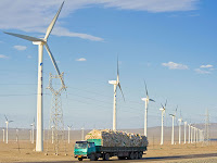Installing wind farms in China's gusty northern provinces, such as here in Xinjiang, may produce more costly energy due to grid integration challenges. (Photo Credit: Paul Springett/Alamy) Click to Enlarge.