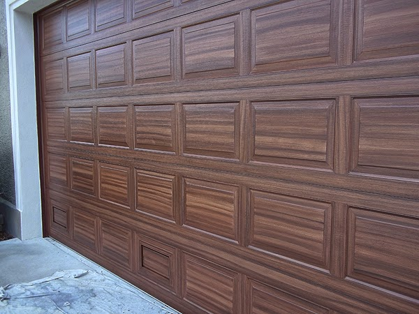 Finished Painting Over Sized Two Car Garage Door