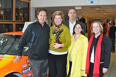 L To R Darrell Waltrip Mary Beth Gates Volunteer Accountant High Hopes Hometown Hero Of The Month John Gallagher General Manager Dwa