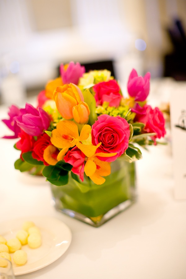 Christine wanted pops of color with black and white. The colorful  centerpieces were so vibrant in the grand ballroom.