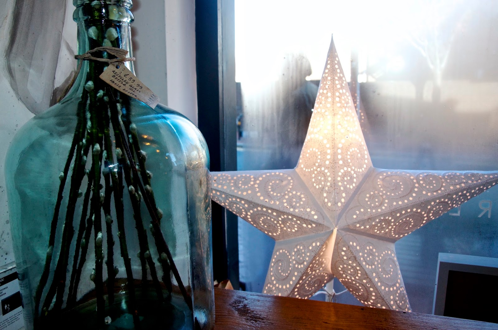 Green glass vase and white paper star
