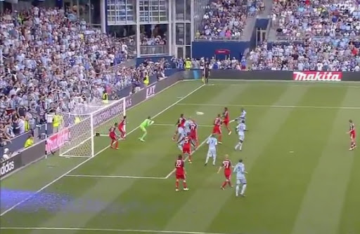 Sporting Kansas City player Júlio César smashes the ball into the net of Toronto FC