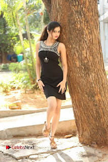 Actress Poojitha Pallavi Naidu Stills in Black Short Dress at Inkenti Nuvve Cheppu Movie Platinum Disc Function  0247.JPG
