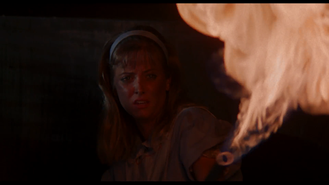 NIGHT OF THE DEMONS: Judy (Cathy Podewell) kicks demon butt with an impromptu flamethrower