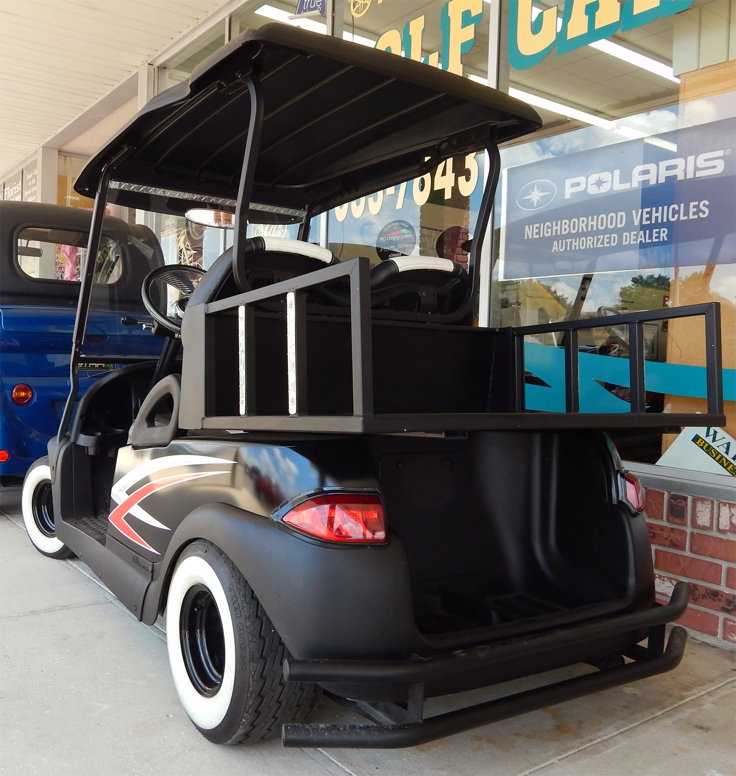 Low Rider Scull And Cross-bolt Club Car Golf Cart In Sun