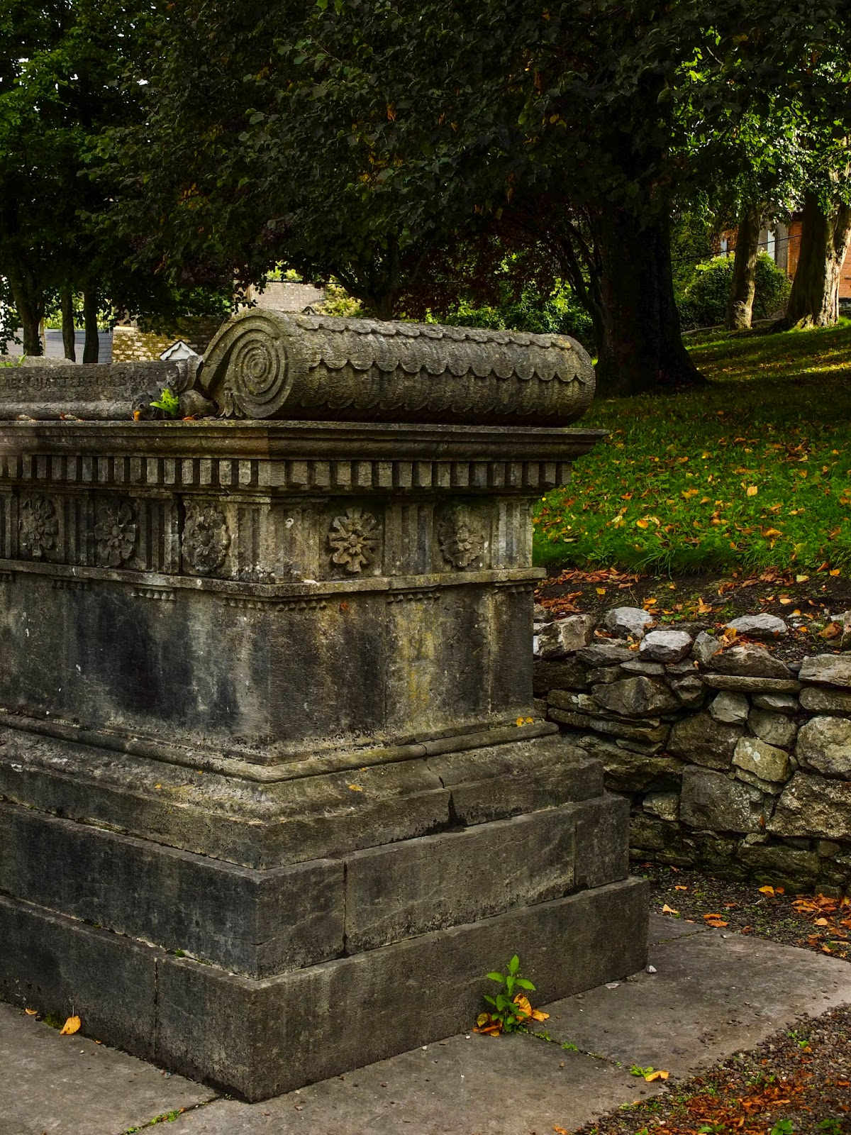 A tomb outside St Fin Barre's Cathedral in Cork City.