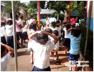 Kids covering their heads proceeding to open space