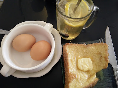 Toasted bread with half boiled egg