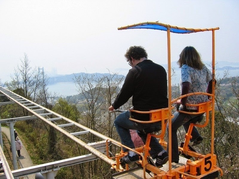 The cars are side by side tandem bikes, making the ride popular for couples. - Japan's Pedal Powered Roller Coaster Is The Most Unintentionally Terrifying Ride Ever.