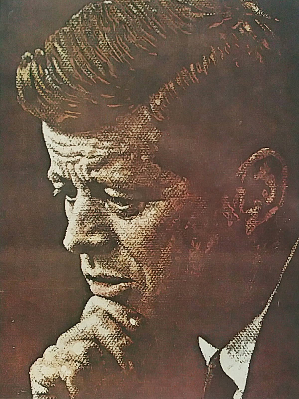 An iconic painting of JFK in thoughtful repose, by Norman Rockwell.