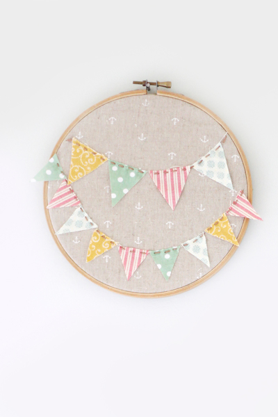 this embroidery hoop art project would be perfect decoration for a nursery or child's room