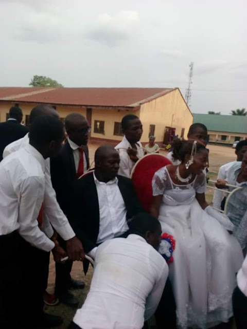 Physically challenged choir master weds in Benue State; rides to the altar with his beaming wife on a motorcycle (photos)