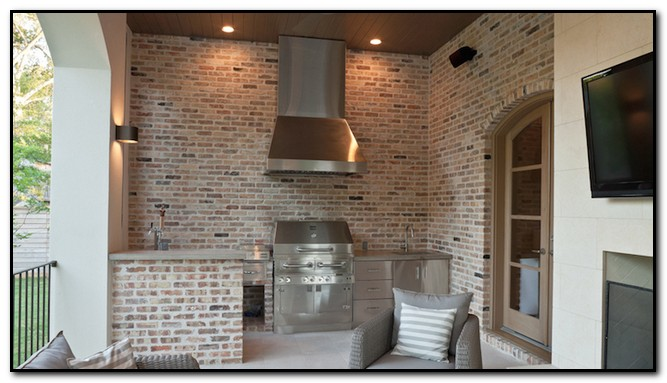 Outdoor Kitchen Hood Ikea Appliances Vent Design Home Beautiful Patio Feature Brick Walls Framing A Stainless Steel Over Bbq Flanked By Cabinets Topped