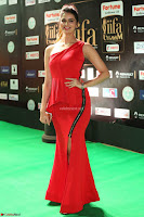 Meenakshi Dixit in Red One Shoulder Red Zipped up gown at IIFA Utsavam Award 83.JPG