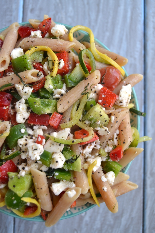 Greek Pasta Salad with Spiralized Noodles makes the perfect lunch or side dish with spiralized zucchini and summer squash, bell peppers, tomato, feta and a homemade vinaigrette. www.nutritionistreviews.com
