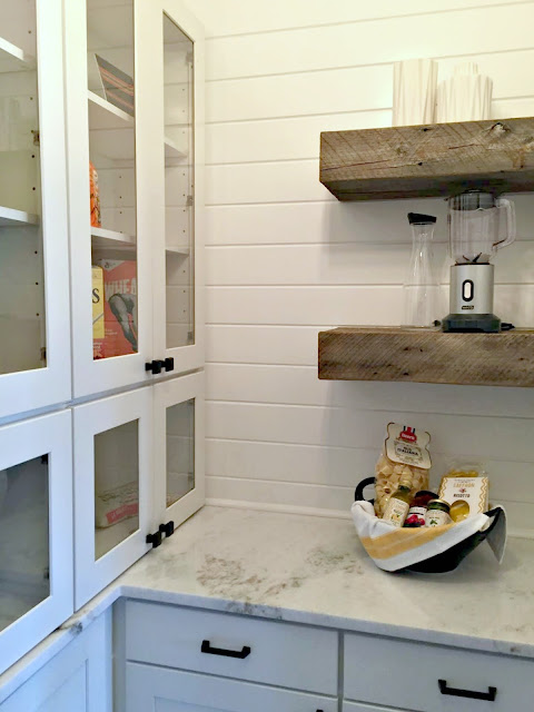 pantry with granite and wood shelves