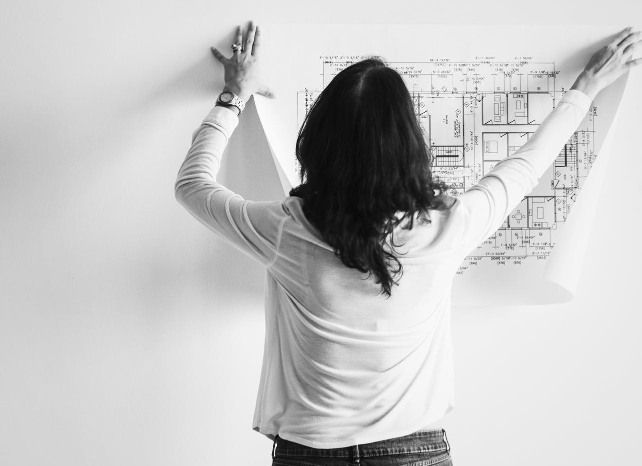 interior designer planning a room before decorating
