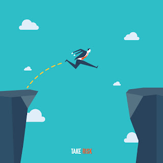 Businessman jumping across the mountain taking risk