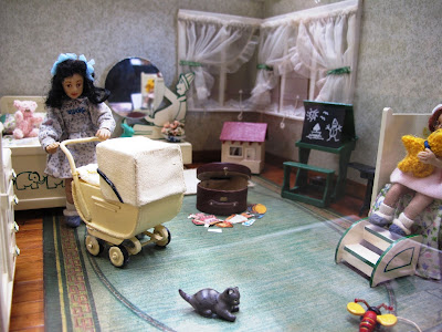 One-twelfth scale miniature 1940s child's bedroom with two girl dolls in it.