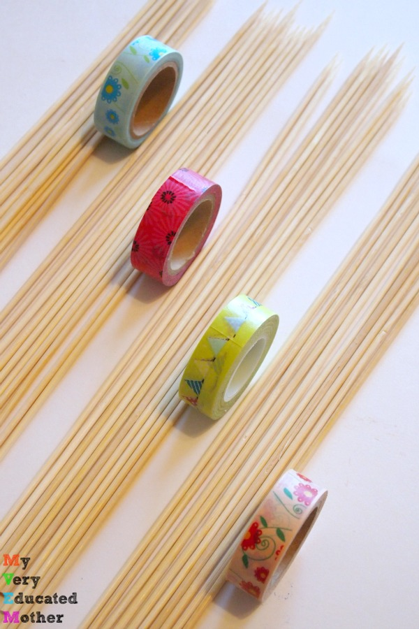 All you need is washi tape, skewers and decoupage medium to make your own Pick-Up Sticks Game.