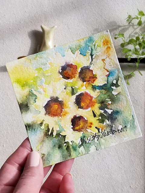 """Soakin' In the Warmth of Sun"" Sunflowers in watercolor 4""x4"" by Christy Sheeler, artist 2019."