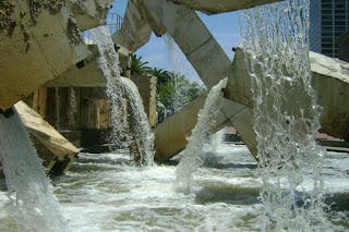water flowing from various structures into fountain basin