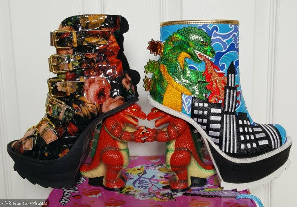 two different dinosaur heeled boots sitting on side