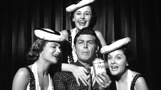Andy Griffith (centre) as Larry 'Lonesome' Rhodes in A Face in the Crowd