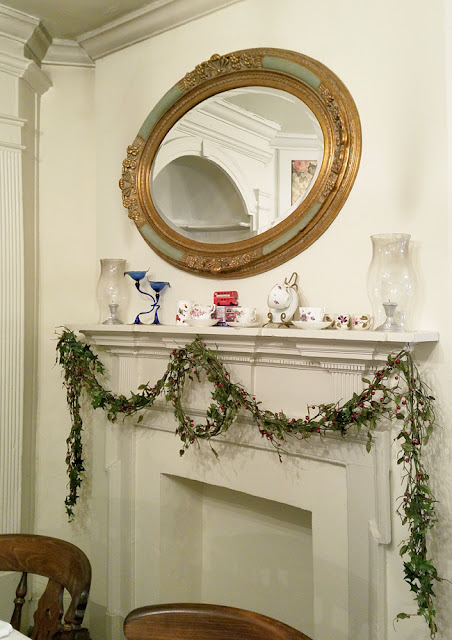 green garland on the mantel
