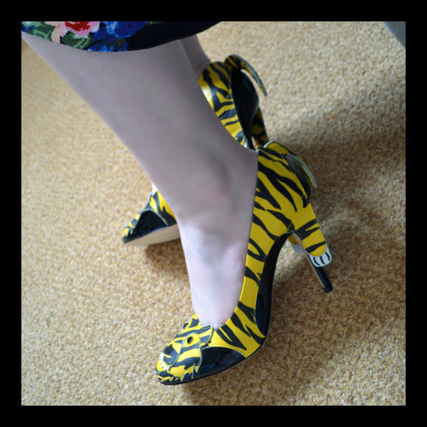 wearing moschino cheap & chic tiger heels