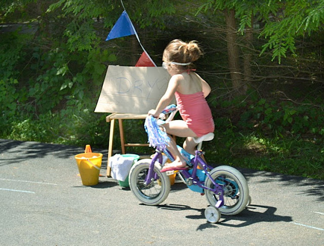 girl riding bike, bike wash, summertime fun, summer kids activities