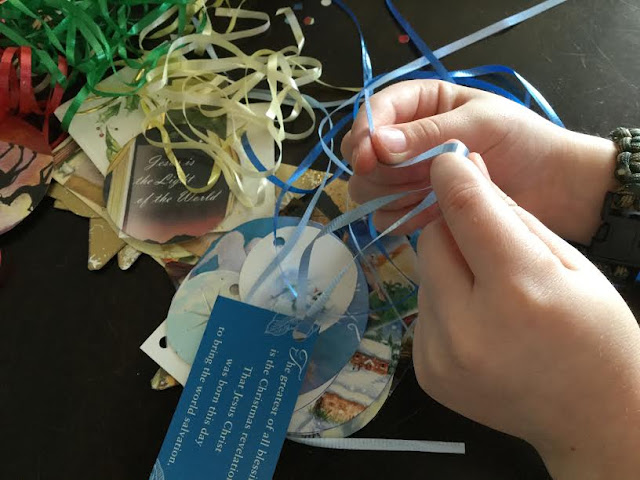 Putting ribbon on homemade gift tag