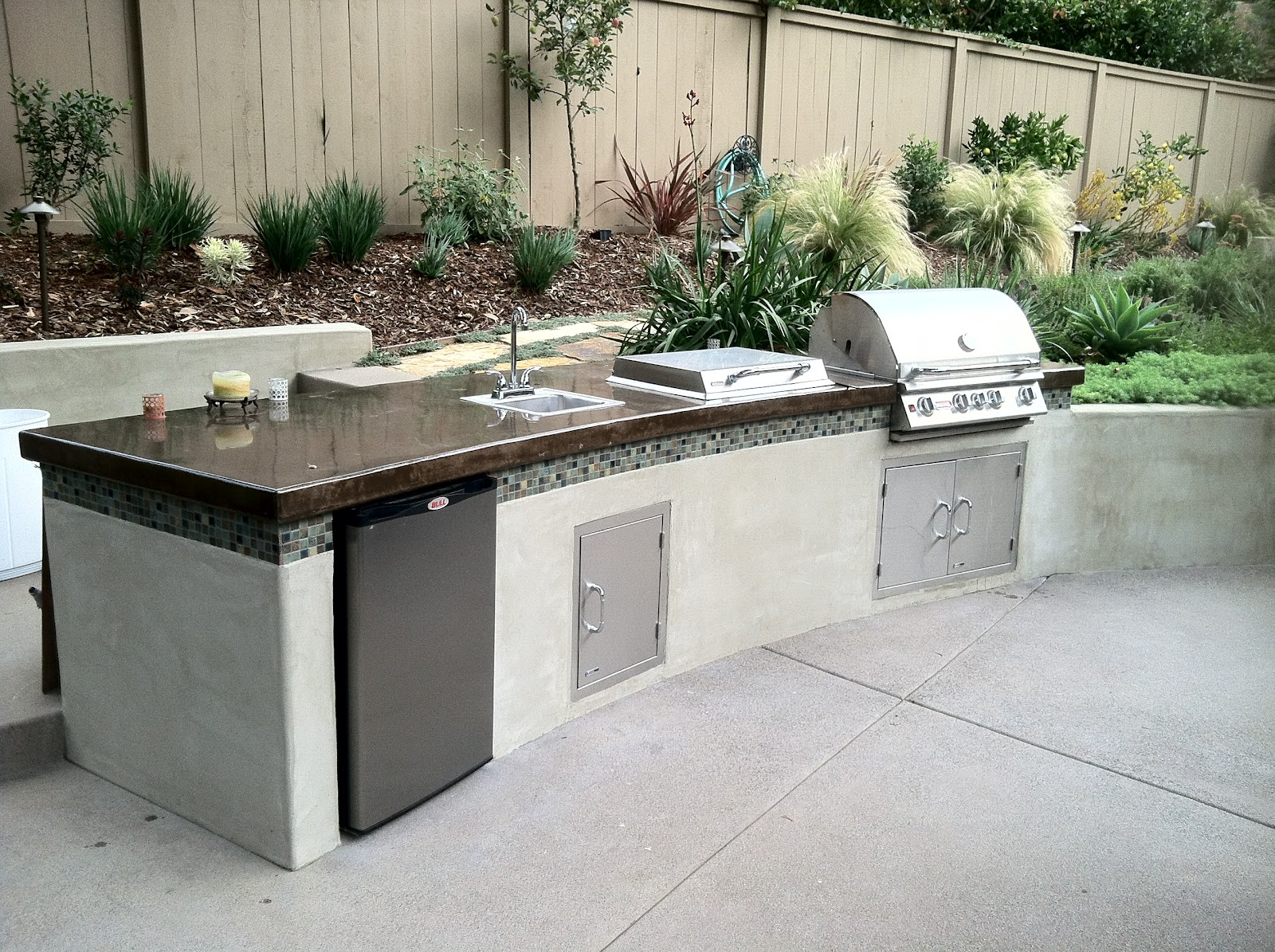 outdoor kitchen island Stucco Stone front with porcelain tile counter and bar ledge even has a stereo and under bar lights Outdoor BBQ Kitchen Islands Pinterest