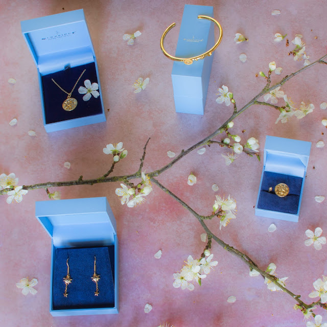 The 4 jewellery items for the giveaway with spring blossom