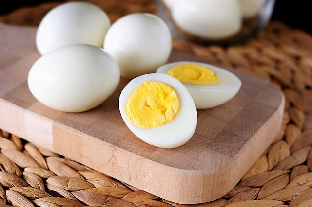 How to Make Deviled Eggs: Hard Boiled Egg Cut in Half Image